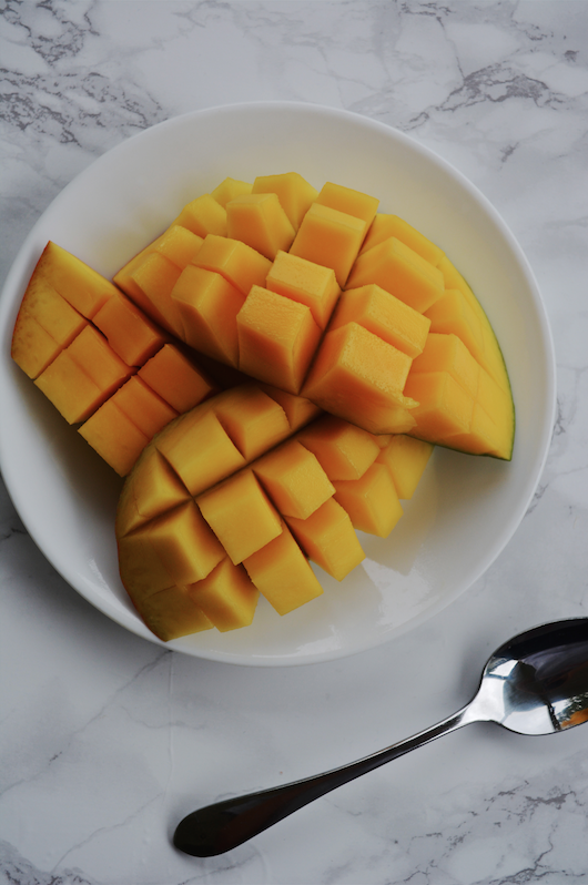 2-Ingredient Mango Popsicles // Classy and Kate